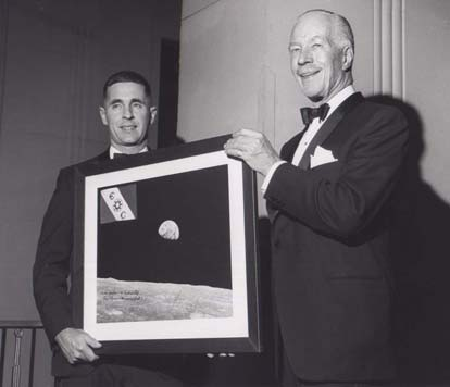 Bill Anders in 1969 being congratulated by the Explorers Club president Walter Wood for a successful mission to the moon